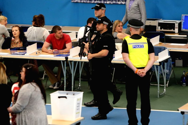 SUNDERLAND (BRITAIN), June 8, 2017 Police stand guard before the votes counting at a polling station in Sunderland, Britain on June 8, 2017. British Prime Minister Theresa May is on ... - Theresa May