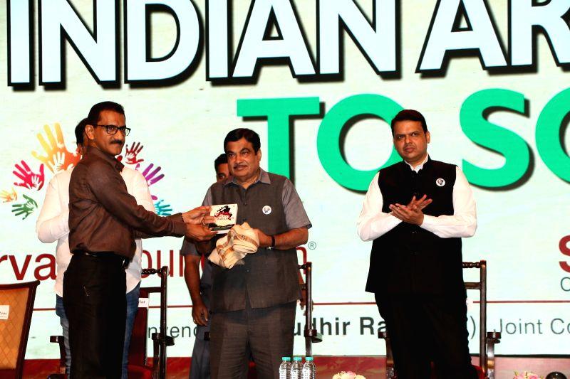 Sunil Rane, Chairman, Atharva Foundation, Road Transport and Highways Minister Nitin Gadkari and Maharashtra Chief Minister Devendra Fadnavis during a programme in Mumbai on Jan 31, 2018. - Nitin Gadkari