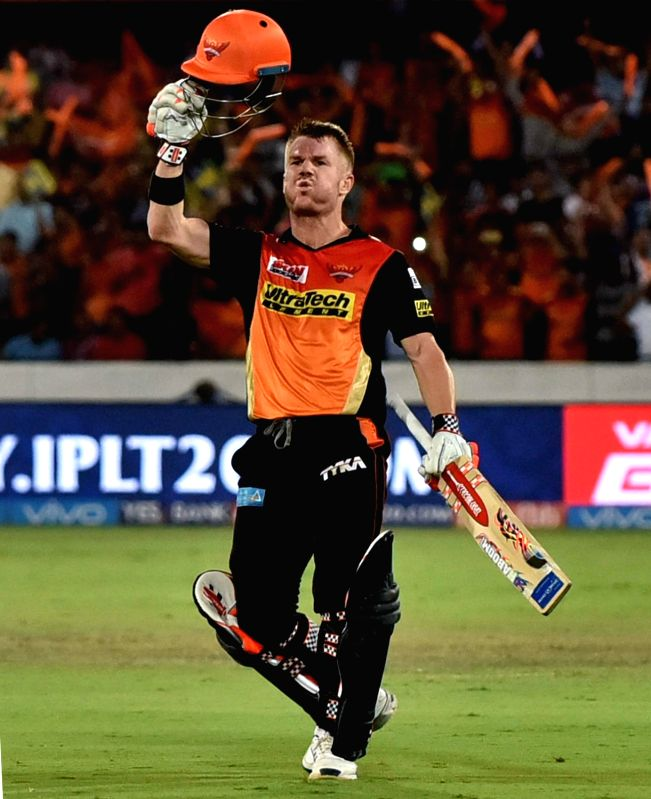 Sunrisers Hyderabad captain David Warner celebrates his century during an IPL 2017 match between Sunrisers Hyderabad and Kolkata Knight Riders at Rajiv Gandhi International Stadium in ... - David Warner