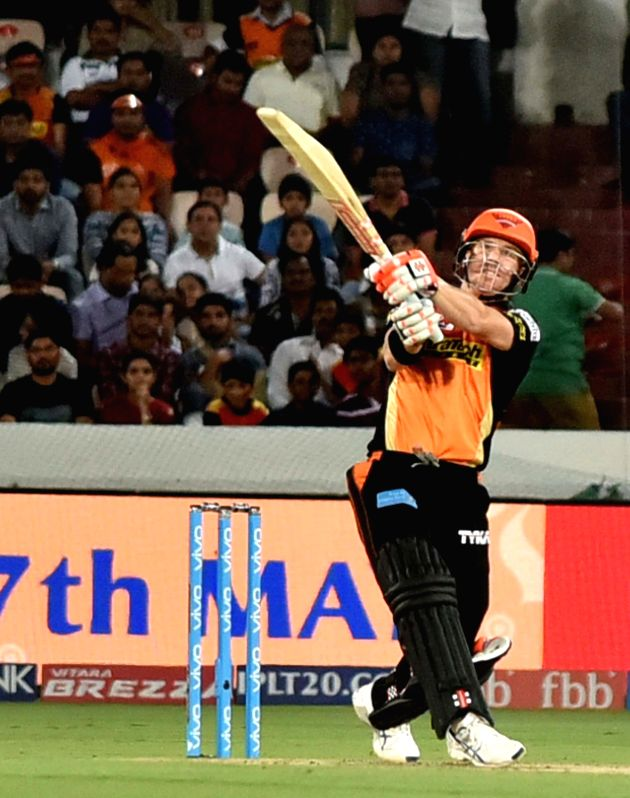 Sunrisers Hyderabad captain David Warner hits a six during an IPL 2017 match between Sunrisers Hyderabad and Kolkata Knight Riders at Rajiv Gandhi International Stadium in Hyderabad on ... - David Warner