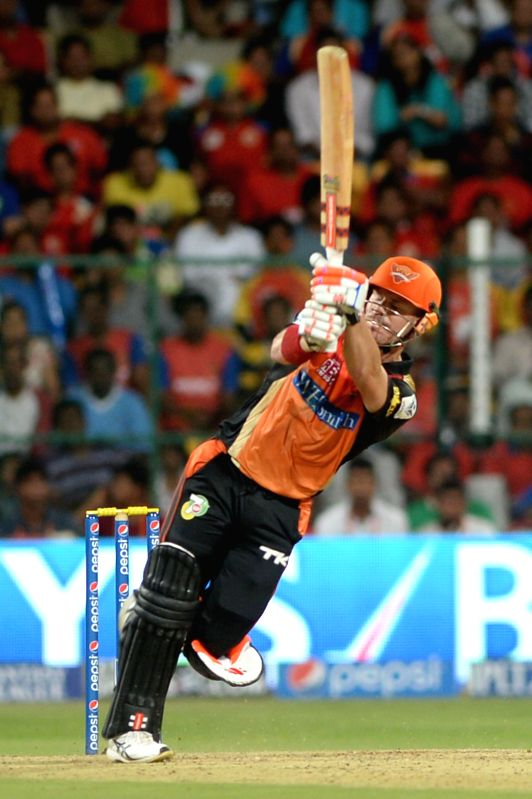 Sunrisers Hyderabad player David Warner in action during the 24th match of IPL 2014 between Sunrisers Hyderabad and Royal Challengers Bangalore at M Chinnaswamy Stadium in Bangalore on May 4, 2014.