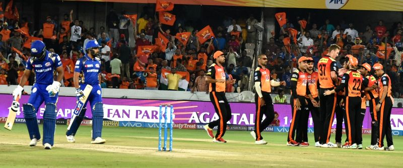 Sunrisers Hyderabad players celebrate fall of Rohit Sharma's wicket during an IPL 2018 match between Sunrisers Hyderabad and Mumbai Indians at Rajiv Gandhi International Cricket Stadium in ... - Rohit Sharma