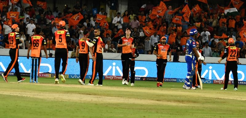 Sunrisers Hyderabad players celebrate fall of Ishan Kishan's wicket during an IPL 2018 match between Sunrisers Hyderabad and Mumbai Indians at Rajiv Gandhi International Cricket Stadium in ...