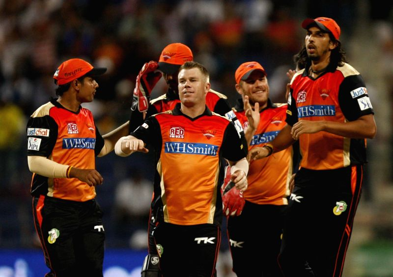 Sunrisers Hyderabad players celebrate fall of a wicket during the fourth match of IPL 2014 between Sunrisers Hyderabad and Rajasthan Royals, played at Sheikh Zayed Stadium in Abu Dhabi of United Arab