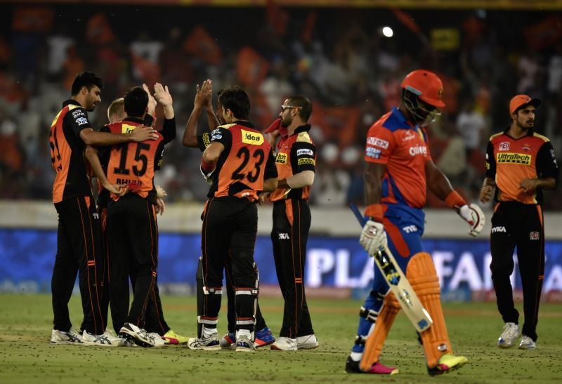 Sunrisers Hyderabad players celebrate fall of a wicket during an IPL match between Sunrisers Hyderabad and Gujarat Lions at Rajiv Gandhi International Stadium in Hyderabad on May 6, 2016.