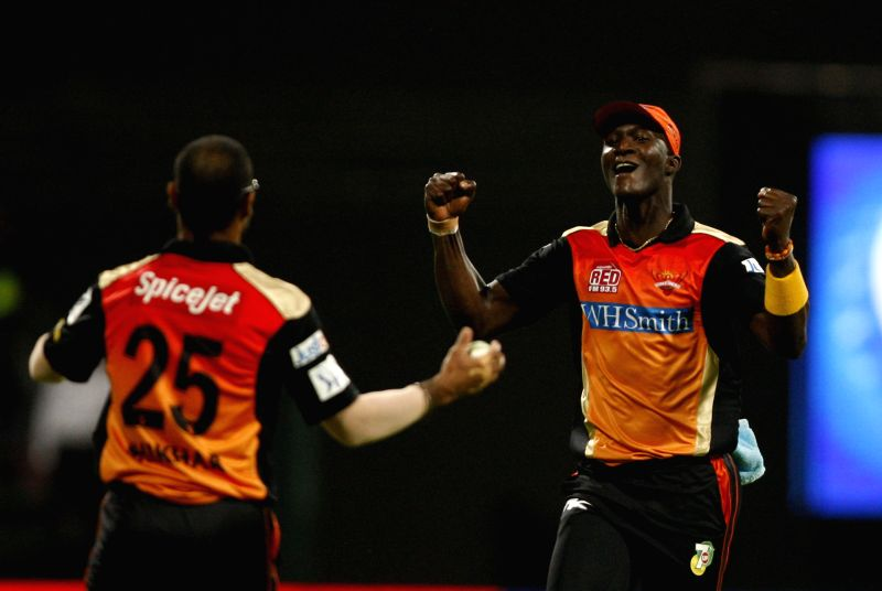 Sunrisers Hyderabad players Shikhar Dhawan and Darren Sammy celebrate fall of a wicket during the fourth match of IPL 2014 between Sunrisers Hyderabad and Rajasthan Royals, played at Sheikh Zayed ... - Shikhar Dhawan