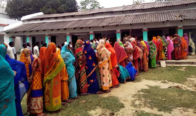 Supaul (Bihar): Voters wait in queues to cast their votes for the third phase of 2019 Lok Sabha elections, at a polling booth in Bihar's Supaul, on April 23, 2019. (Photo: IANS)