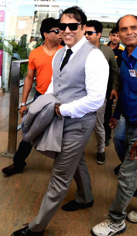 Superstar Gobinda arrives at the airport in Jaipur on Aug. 23, 2014.