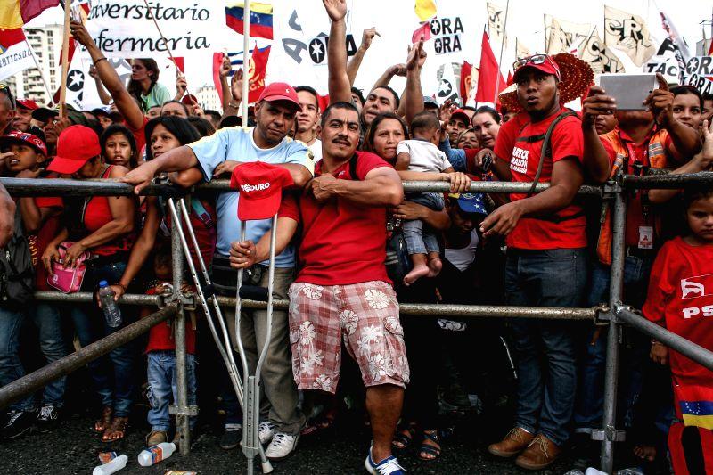 Supporters attend a closing campaign act of the Great Patriotic Pole (GPP) headed by Venezuelan President Nicolas Maduro, in Caracas, Venezuela, on Dec. 3, 2015. ...
