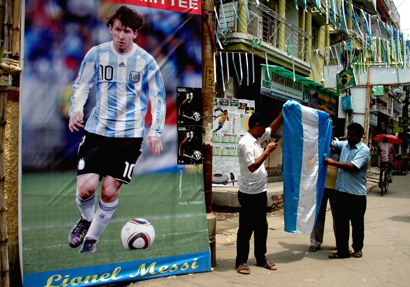 Supporters of Argentine football team with Argentine flag in Kolkata on July 1, 2014.