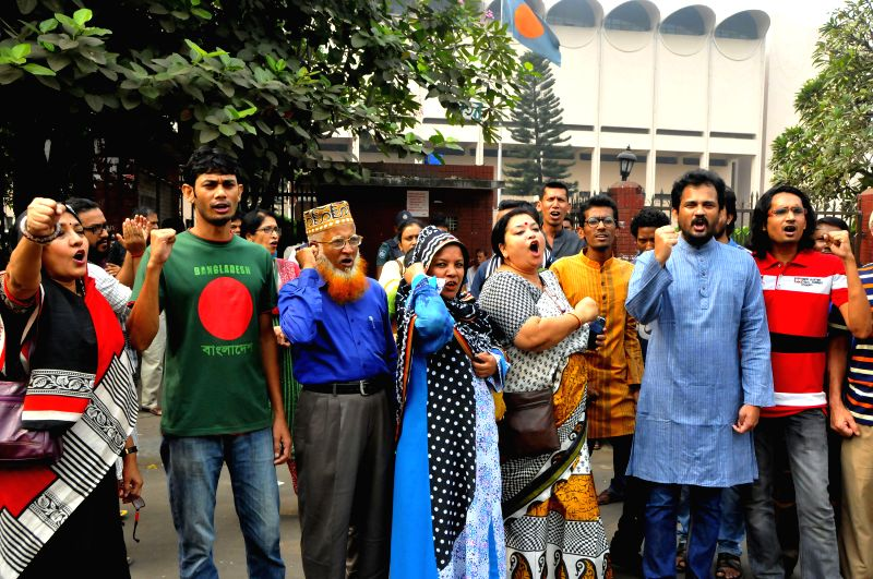 Supporters of Bangladesh's ruling party cheer and shout slogans outside the court in Dhaka, Bangladesh, Nov. 18, 2015. Bangladesh's highest court has rejected appeals ...