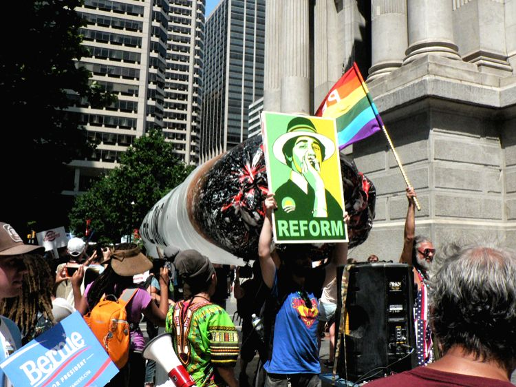 Supporters of Bernie Sanders, who lost the Democratic Party Presidential nomination, parade with a giant marijuana cigar-shaped  balloon at protest in Philadelphia, Monday, July 25, 2016. They demand ...