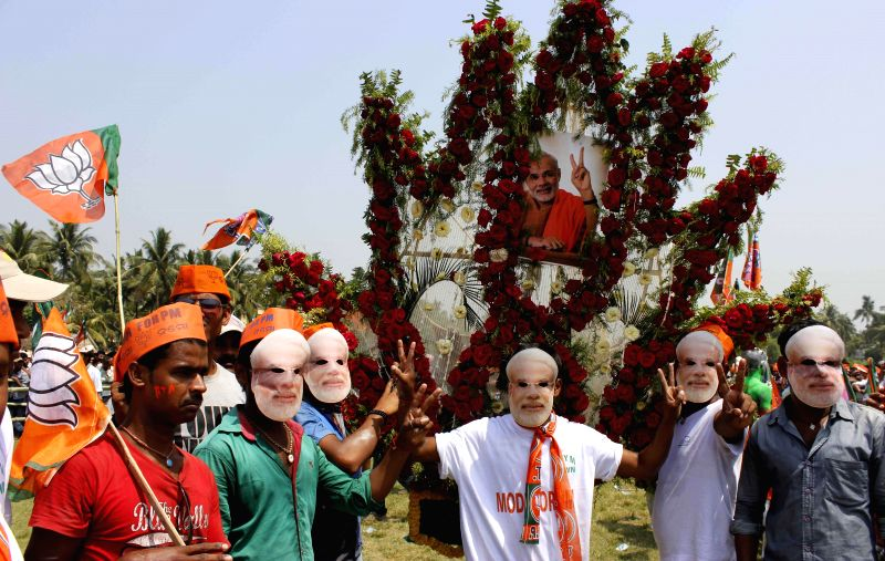 Supporters of BJP Prime Ministerial candidate and Gujarat Chief Minister Narendra Modi gather at the venue of his rally in Balasore of Odisha on April 11, 2014.