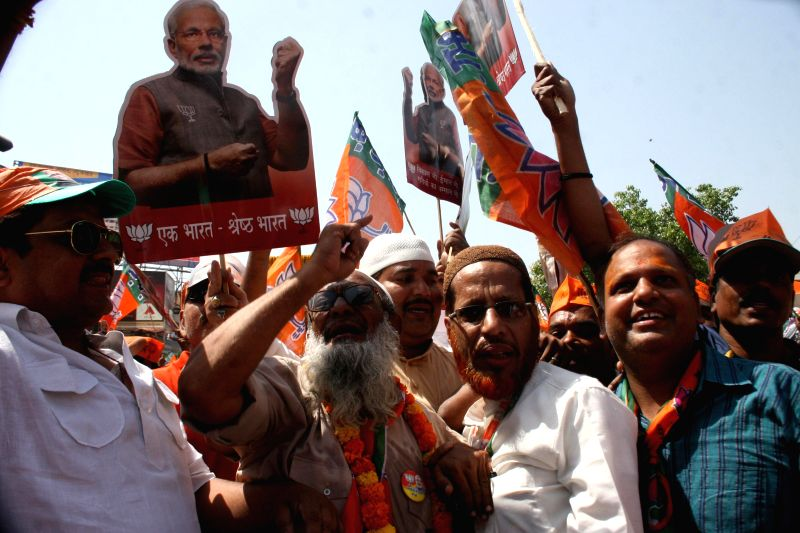 Supporters of BJP Prime Ministerial candidate and Gujarat Chief Minister Narendra Modi during a road show in Varanasi on April 24, 2014.