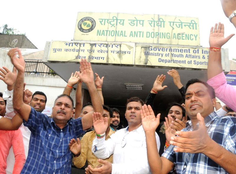 Supporters of Indian wrestler Narsingh Pancham Yadav stage a demonstration outside the National Anti Doping Agency (NADA) office in New Delhi on July 27, 2016. - Narsingh Pancham Yadav