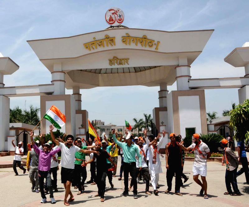 Supporters of Yoga Guru Ramdev celebrate 2014 Lok Sabha election results at Patanjali Yogpeeth in Haridwar on May 16, 2014.