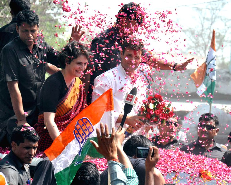 Supporters showers rose petals as Congress vice president Rahul Gandhi along with his sister Priyanka Vadra on his way to file nomination papers for Amethi Lok Sabha seat in Amethi on April 12, 2014.