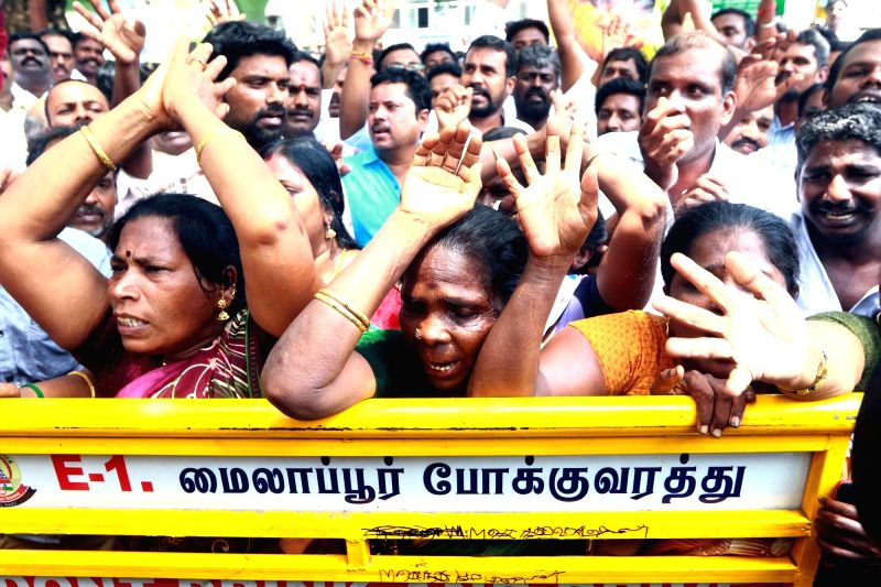 Supporters wait for updates on the health of DMK President M. Karunanidhi outside the Kauvery Hospital where he is admitted, in Chennai, on July 30, 2018.