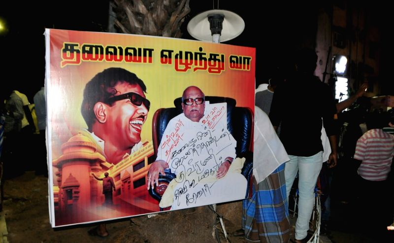 Supporters wait for updates on the health of DMK President M. Karunanidhi outside the Kauvery Hospital where he is admitted, in Chennai on Aug 6, 2018. Karunanidhi's health has deteriorated ...