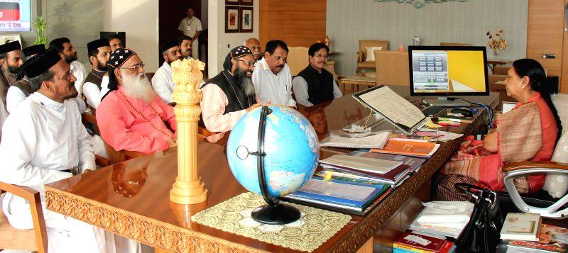 Supreme head of Indian Orthodox Church Moran Mar Baselios calls on Gujarat Chief Minister Anandiben Patel in Gandhinagar on Aug 21, 2014. - Anandiben Patel