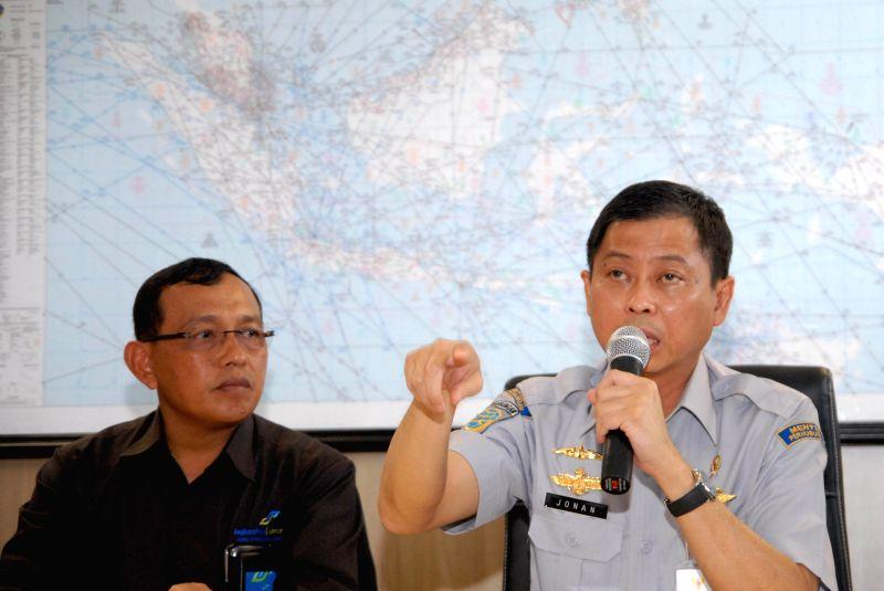 Transportation Minister of Indonesia Ignasius Jonan(R) speaks at a press conference for Air Asia missing flight QZ8501 at Juanda international airport in Surabaya .