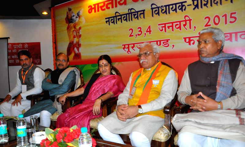 Union Minister for External Affairs Sushma Swaraj, Haryana Chief Minister Manohar Lal Khattar, Haryana BJP chief Subhash Barala at the Training Programme of newly elected Members of ... - Manohar Lal Khattar