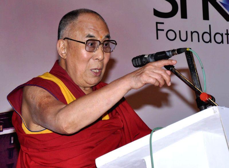 Dalai Lama the spiritual head of Tibetan Buddhists during a programme organised to confer Manav Ratna Award in Surat, on Jan 1, 2015.