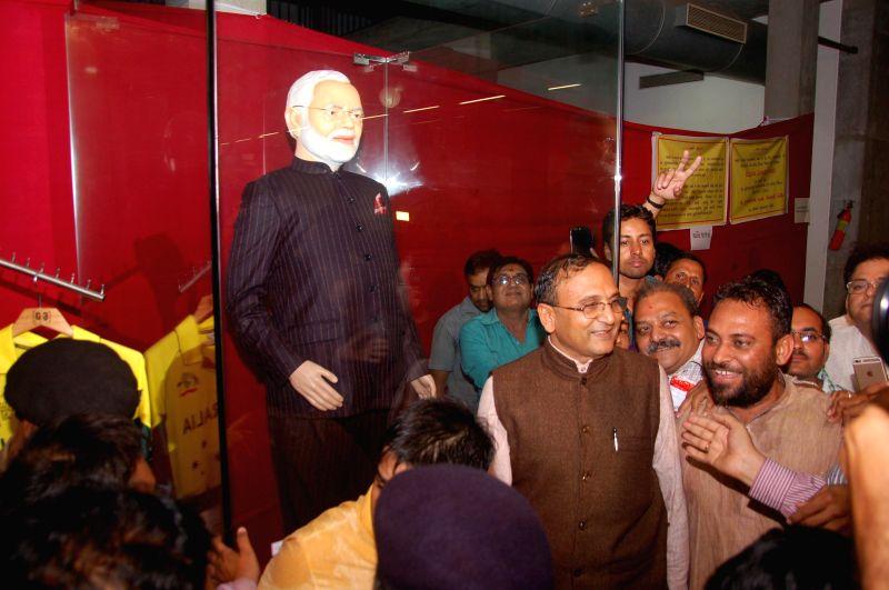 Diamond merchant Lalji Patel, chairman of the Dharmanandan Diamonds Pvt. Ltd who bought Prime Minister Narendra Modi's famous 'name-striped' suit for a staggering Rs.4.31 crore at a charity ... - Narendra Modi and Lalji Patel