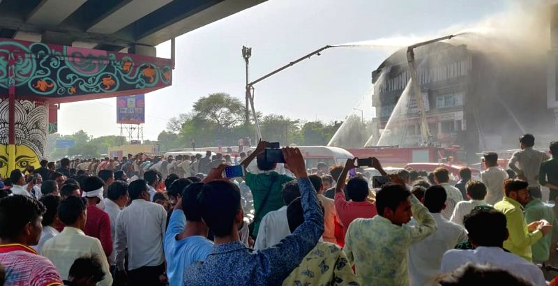 Surat: Fire fighting operations underway after a massive fire broke out at a coaching centre atop a four-storey building, in Sarthana area of Gujarat's Surat on May 24, 2019. 17 students were killed in the incident. (Photo: IANS)