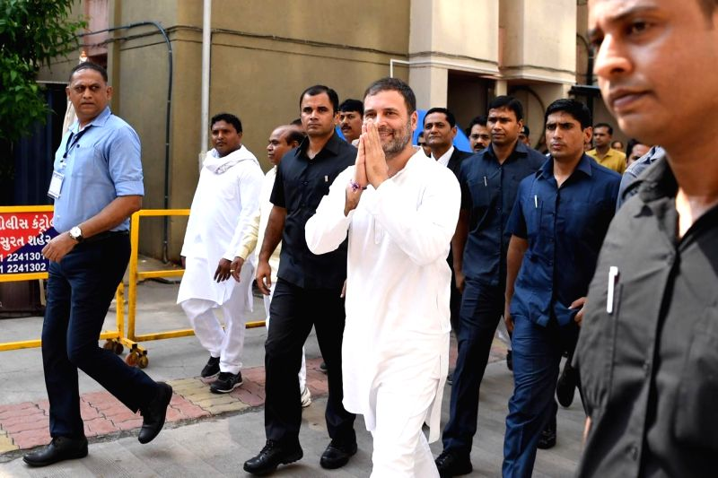 """Surat (Gujarat): Congress leader Rahul Gandhi arrives to appear before a magisterial court in connection with a criminal defamation case filed against him for his """"why all thieves share the Modi surname"""" remarks, in Gujarat's Surat on Oct 10, 2019. ("""