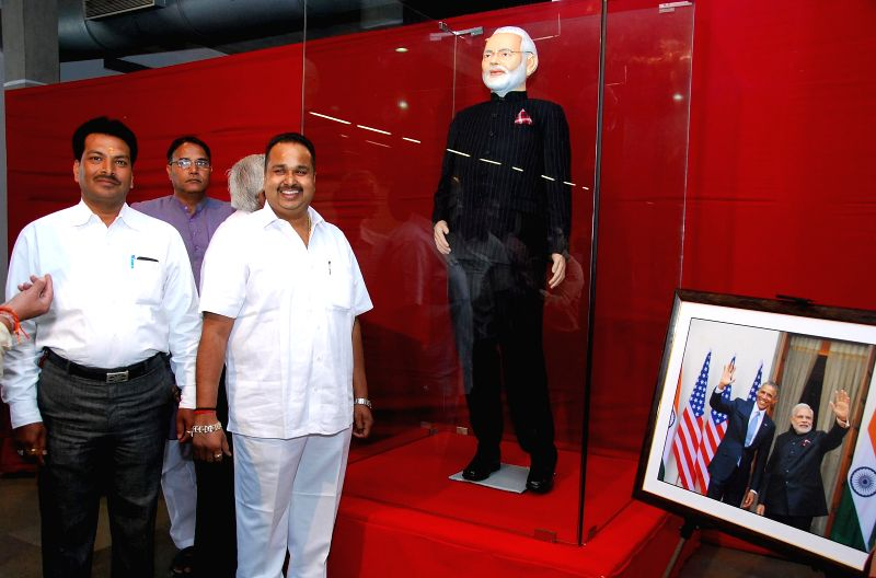 Prime Minister Narendra Modi's `name-striped` suit on display at a charity auction organised in Surat, Gujarat on Feb 18, 2015. - Narendra Modi