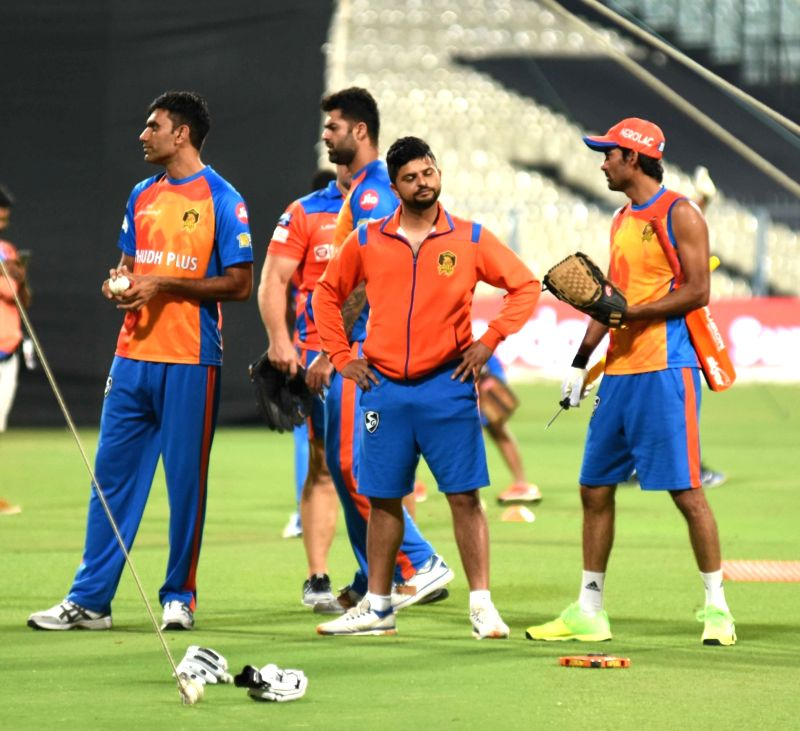 Suresh Raina, Munaf Patel and Manpreet Goni of Gujarat Lions with assistant coach Mohammad Kaif during a practice session in Kolkata on April 20, 2017. - Munaf Patel