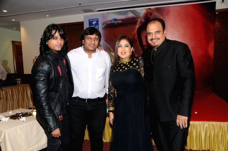 Suresh Thomas (Cresendo-Universal Music) with singer Nikita H Chandiramani, Aziz Zee and Mr. Chandiramani during the music release of album Kiran, in Mumbai, on Aug 18, 2014.