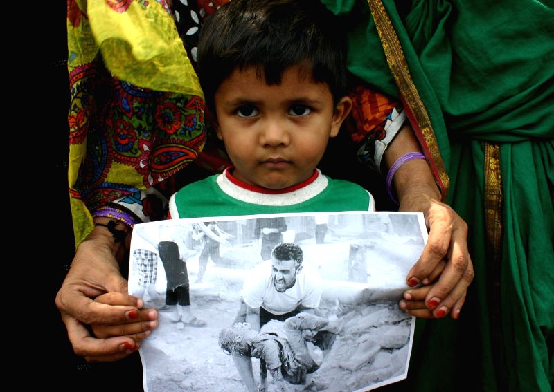 Survivors of Bhopal gas tragedy demonstrate against the ongoing Israeli–Palestinian conflict, in Bhopal on July 12, 2014.