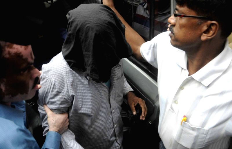 Suspected Pakistan`s Inter-Services Intelligence (ISI) agents being taken to be produced before court in Kolkata on Nov 30, 2015.