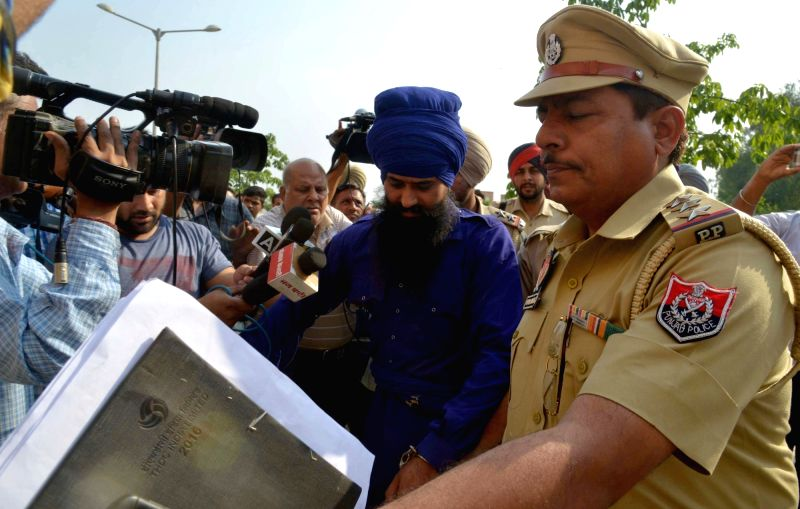 Suspected terrorists Mann Singh, 40 and Sher Singh, 28, being taken to be produced before an Amritsar court on May 22, 2017. The duo were nabbed by BSF troopers on Sunday morning when they ... - Sher Singh