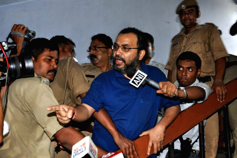 Suspended Trinamool Congress parliamentarian Kunal Ghosh being produced at Bidhan Nagar court for his alleged involvement in multi-crore Saradha Group chit fund scam in Kolkata on April 29, 2014.