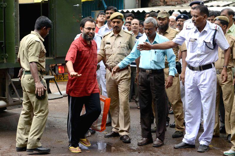 Suspended Trinamool Congress Rajya Sabha member Kunal Ghosh being produced at Alipore court in Kolkata on June 23, 2014.
