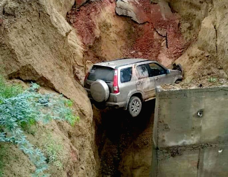 SUV reportedly carrying four people that fell into a 50-feet deep ditch after a portion of Agra-Lucknow Expressway caved in, on Aug 1, 2018.