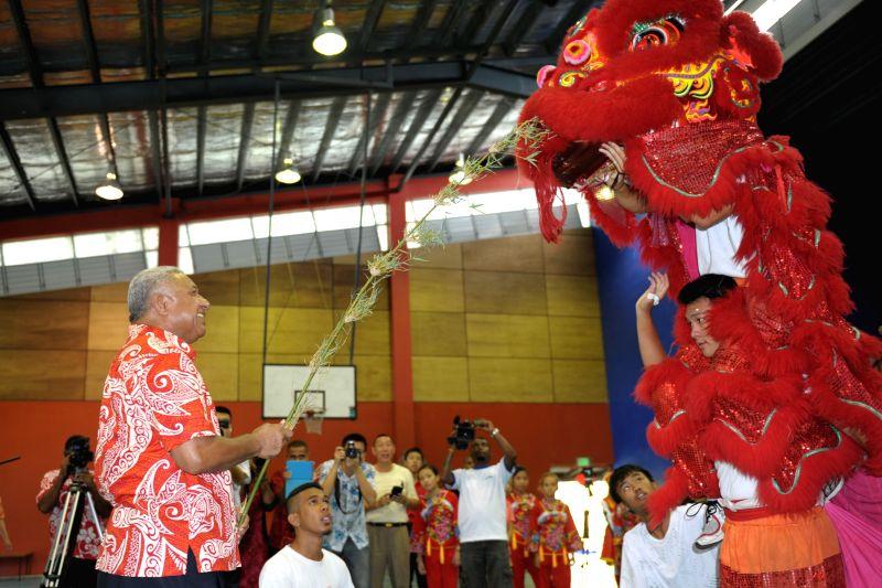 Fijian Prime Minister Voreqe Bainimarama participates in the lion dance in Suva, Fiji, Feb. 22, 2015. Fijian Prime Minister Voreqe Bainimarama celebrated Chinese ... - Voreqe Bainimarama