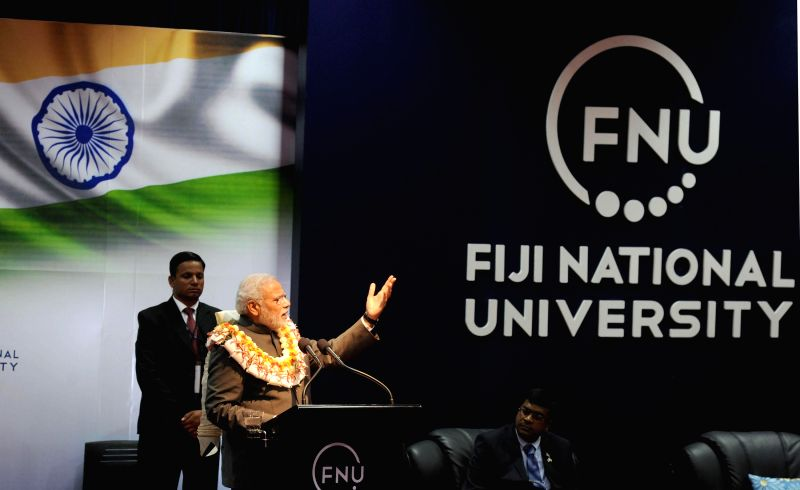Prime Minister, Narendra Modi addresses during an interaction with civil society groups, at Fiji National University, in Suva, Fiji on Nov 19, 2014. - Narendra Modi