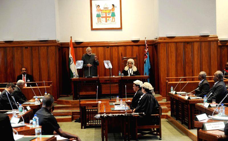 Prime Minister, Narendra Modi addresses the Parliament of Fiji, in Suva, Fiji on Nov 19, 2014. - Narendra Modi