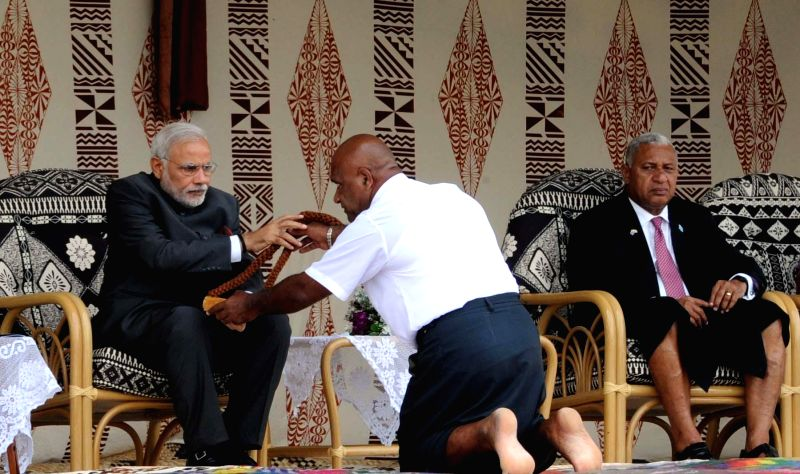Prime Minister Narendra Modi being given traditional welcome, in Suva, Fiji on Nov 19, 2014. Also seen the Prime Minister of Fiji, Frank Bainimarama is also seen. - Narendra Modi