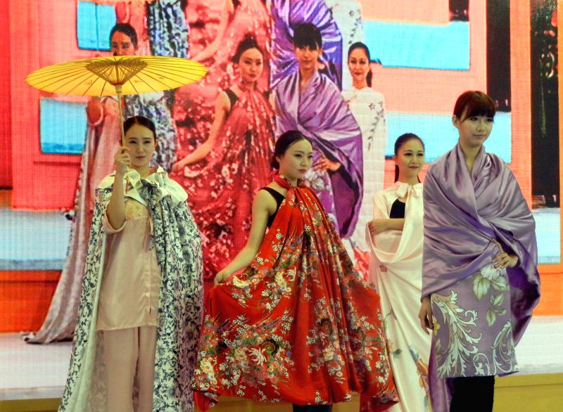 Models present bed sheets during a bed sheet show in Suzhou, east China's Jiangsu Province, April 19, 2014.