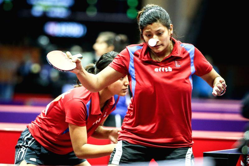 Nepal's Elina Marharjan/Nabita Shrestha compete during the women's doubles qualification match against Greece's Angeliki Papadaki/Aikaterini Toliou at the 53rd ...