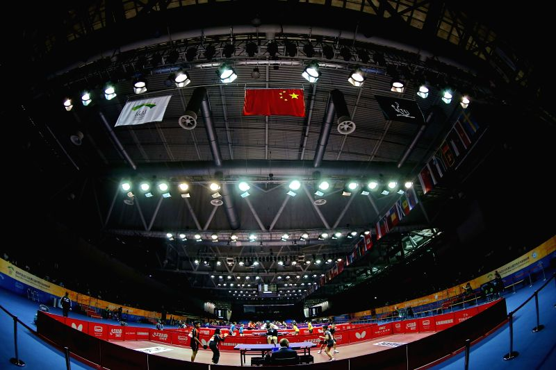 Players compete during the mixed doubles qualification match at the 53rd Table Tennis World Championships in Suzhou, city of east China's Jiangsu Province, April ...