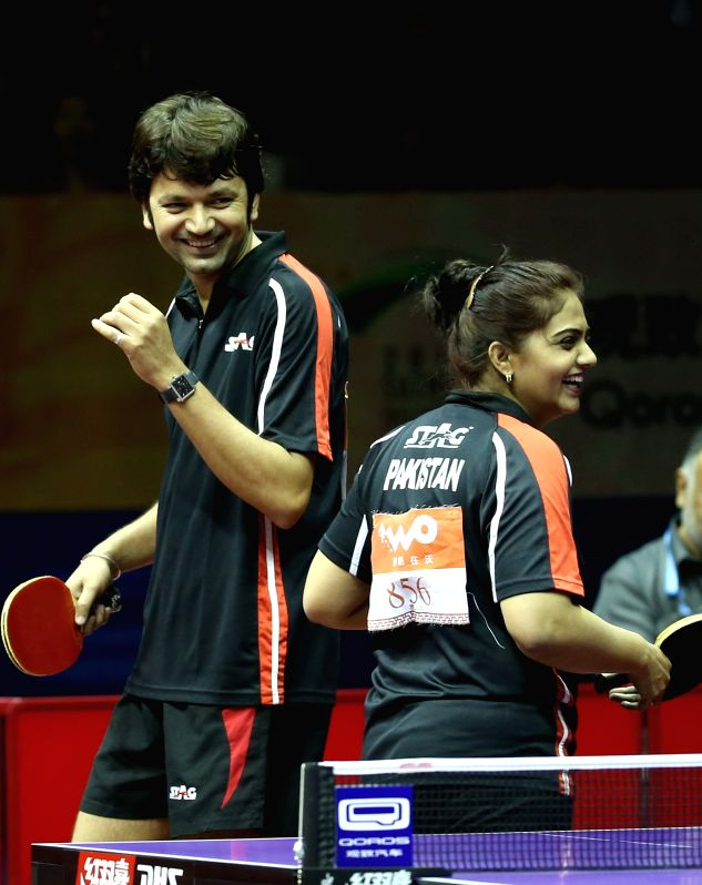 Pakistan's Saleem Abbas(L)/Aisha Ansari compete against France's Emmanuel Lebesson/China's Chen Meng during Mixed Doubles match at the 53rd Table Tennis World ...