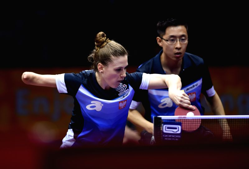 Poland's Natalia Partyka(L)/Wang Zengyi compete against Uzbekistan's Zokhid Kenjaev/Olga Kim during Mixed Doubles match at the 53rd Table Tennis World Championships ...