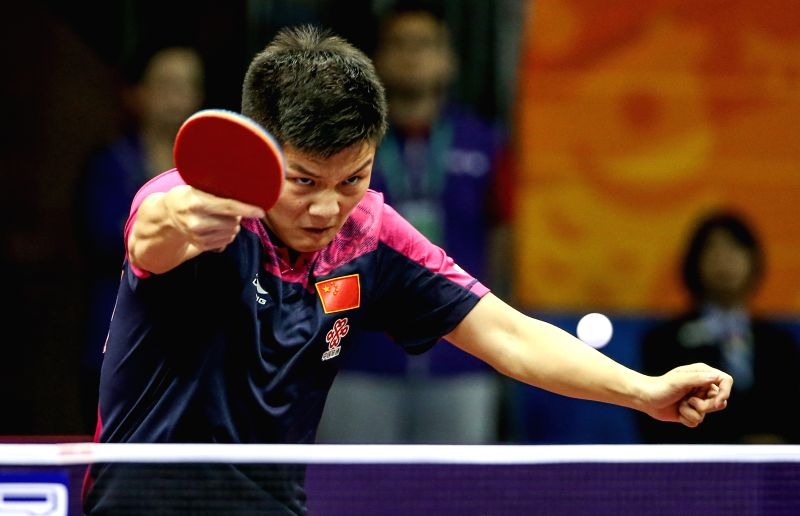 China's Fan Zhendong acts against Romania's Constantin Cioti during Men's Singles match at the 53rd Table Tennis World Championships in Suzhou, city of east China's ...