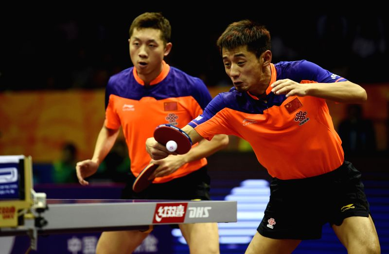 China's Xu Xin(L)/Zhang Jike compete during the Men's Doubles match against China's Ma Long/Germany's Timo Boll at the 53rd Table Tennis World Championships in ...